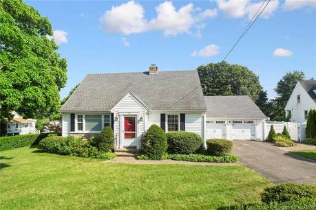 Single Family Home Sold in Fairfield CT 06825.  cape cod house near waterfront with 2 car garage.