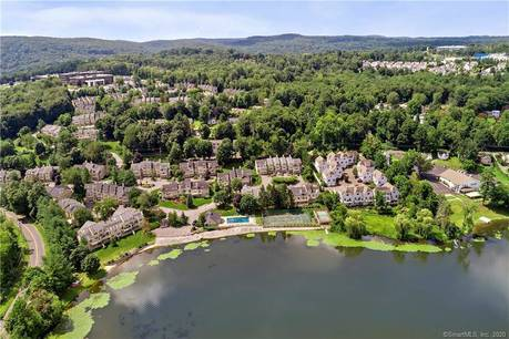 Condo Home For Sale in Danbury CT 06810.  townhouse near lake side waterfront with swimming pool and 2 car garage.