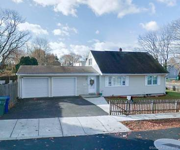 Single Family Home Sold in Bridgeport CT 06610.  cape cod house near beach side waterfront with swimming pool and 2 car garage.