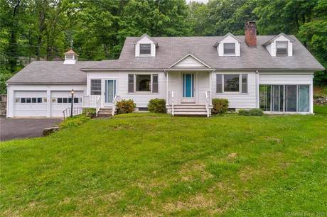 Single Family Home Sold in Redding CT 06896.  cape cod house near waterfront with 4 car garage.