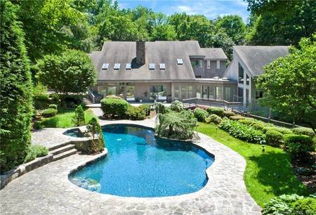Single Family Home Sold in Greenwich CT 06831. Contemporary house near waterfront with swimming pool and 3 car garage.