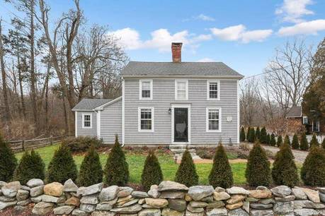 Single Family Home For Sale in Wilton CT 06897. Old antique house near waterfront with 2 car garage.