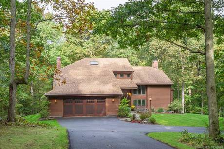Single Family Home Sold in Wilton CT 06897. Contemporary house near waterfront with 2 car garage.