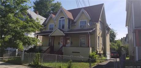 Multi Family Home Sold in Bridgeport CT 06605. Old  house near waterfront with 5 car garage.
