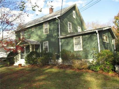Multi Family Home For Sale in Fairfield CT 06825. Old  house near river side waterfront with 2 car garage.