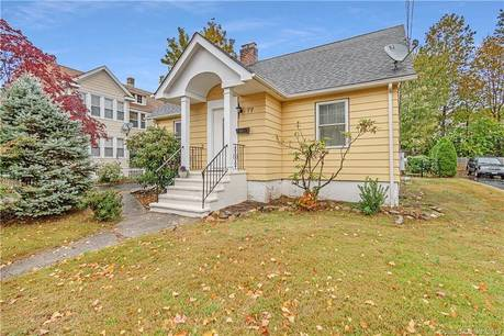 Single Family Home Sold in Norwalk CT 06855.  cape cod house near beach side waterfront with 1 car garage.