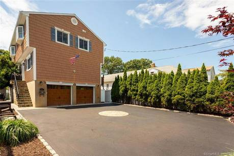 Multi Family Home Sold in Stamford CT 06902.  house near beach side waterfront with swimming pool and 1 car garage.