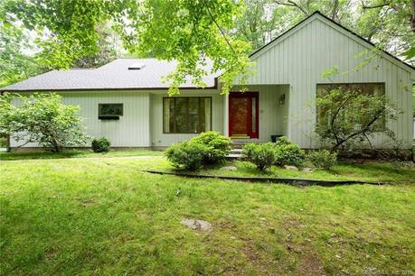Single Family Home For Sale in Wilton CT 06897. Contemporary cape cod house near waterfront with 2 car garage.