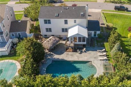 Single Family Home Sold in Fairfield CT 06824. Colonial house near beach side waterfront with swimming pool and 1 car garage.