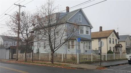 Multi Family Home Sold in Bridgeport CT 06608. Old  house near beach side waterfront with 2 car garage.