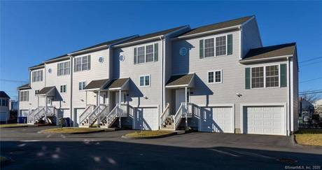 Condo Home Sold in Bridgeport CT 06607.  townhouse near waterfront with 2 car garage.