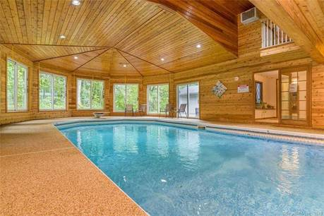 Single Family Home Sold in Bethel CT 06801. Contemporary house near waterfront with swimming pool and 2 car garage.
