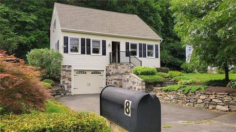 Single Family Home For Sale in Bethel CT 06801.  cape cod house near waterfront with 2 car garage.