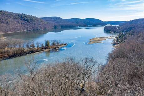 Single Family Home Sold in Sherman CT 06784. Contemporary, ranch house near waterfront with 2 car garage.