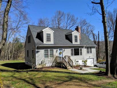 Single Family Home Sold in Newtown CT 06482.  cape cod house near beach side waterfront with 1 car garage.