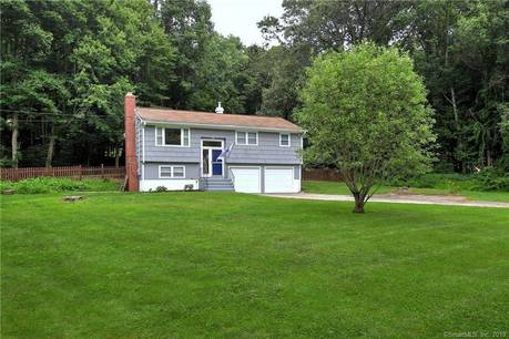 Single Family Home For Sale in Newtown CT 06470. Ranch house near waterfront with 2 car garage.