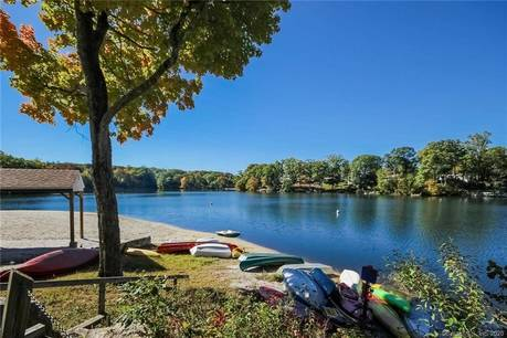 Single Family Home For Sale in Danbury CT 06810. Ranch house near lake side waterfront.