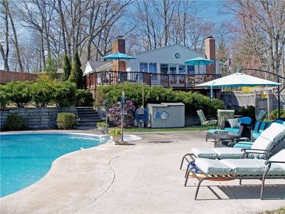 Single Family Home Sold in Norwalk CT 06850. Contemporary, ranch house near waterfront with swimming pool and 2 car garage.