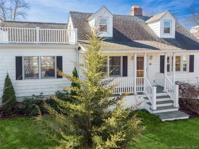 Single Family Home Sold in Greenwich CT 06878.  cape cod house near beach side waterfront with 1 car garage.