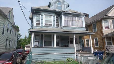 Multi Family Home Sold in Bridgeport CT 06608. Old  house near beach side waterfront with swimming pool and 2 car garage.