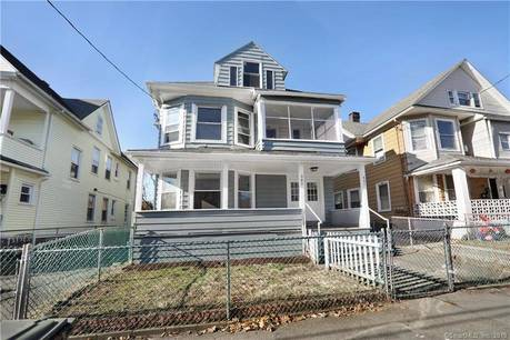 Multi Family Home Sold in Bridgeport CT 06608. Old  house near waterfront with 1 car garage.