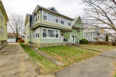 Multi Family Home Sold in Bridgeport CT 06605. Old  house near beach side waterfront with 3 car garage.