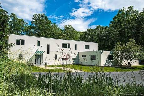Single Family Home Sold in Weston CT 06883. Contemporary house near waterfront with swimming pool and 2 car garage.