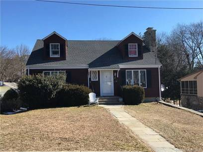Single Family Home Sold in Fairfield CT 06825.  cape cod house near beach side waterfront with 1 car garage.