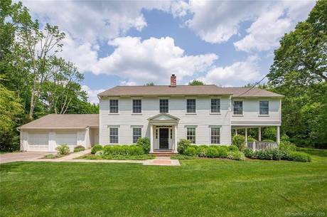 Single Family Home Sold in Fairfield CT 06890. Colonial house near beach side waterfront with swimming pool and 2 car garage.
