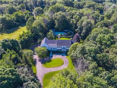 Single Family Home Sold in Weston CT 06883. Colonial house near waterfront with swimming pool and 3 car garage.