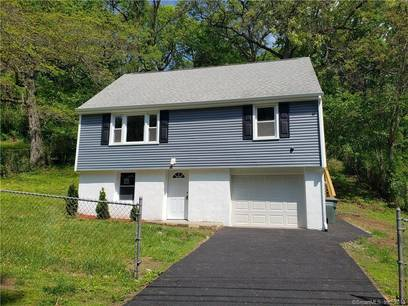 Single Family Home For Sale in Bridgeport CT 06606.  cape cod house near beach side waterfront with 1 car garage.