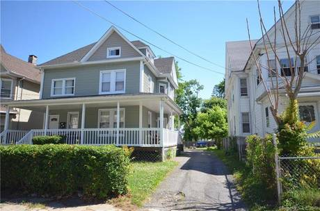 Multi Family Home Sold in Bridgeport CT 06604. Old  house near waterfront with 6 car garage.