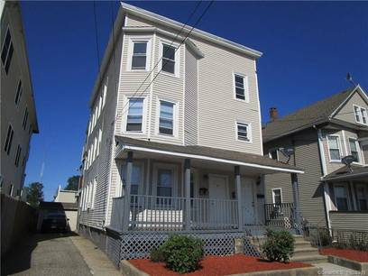 Multi Family Home Sold in Bridgeport CT 06605. Old  house near beach side waterfront with 1 car garage.