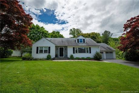 Single Family Home Sold in Trumbull CT 06611.  cape cod house near beach side waterfront with 2 car garage.