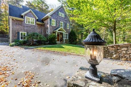 Single Family Home Sold in Ridgefield CT 06877. Colonial house near river side waterfront with 2 car garage.