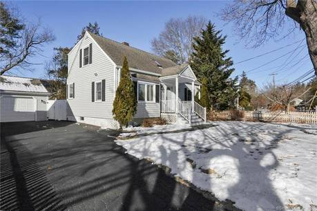 Single Family Home Sold in Fairfield CT 06890.  cape cod house near beach side waterfront with 1 car garage.