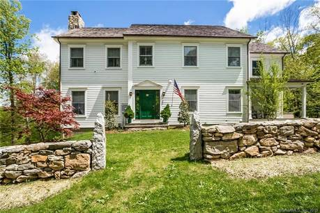 Single Family Home Sold in Greenwich CT 06831. Colonial house near lake side waterfront with 2 car garage.