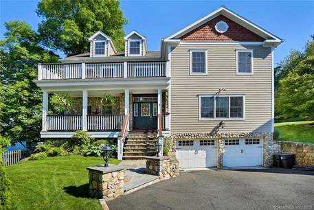 Single Family Home Sold in Greenwich CT 06831. Colonial house near beach side waterfront with 2 car garage.
