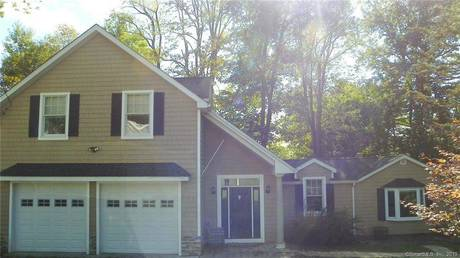 Single Family Home For Rent in New Fairfield CT 06812. Contemporary house near beach side waterfront with 2 car garage.