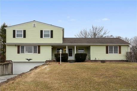 Multi Family Home For Sale in Danbury CT 06811.  house near beach side waterfront with 2 car garage.