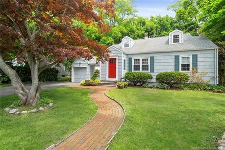 Single Family Home Sold in Stamford CT 06905.  cape cod house near river side waterfront with 1 car garage.