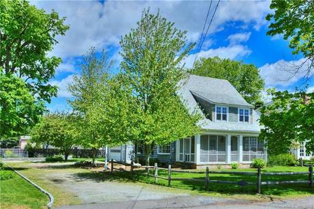 Single Family Home Sold in Westport CT 06880. Old  cape cod house near beach side waterfront with 2 car garage.