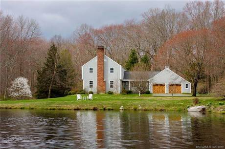 Single Family Home Sold in Redding CT 06896. Colonial house near beach side waterfront with 2 car garage.