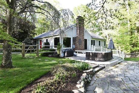 Single Family Home Sold in Weston CT 06883. Ranch house near beach side waterfront with swimming pool and 2 car garage.