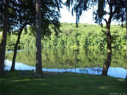 Single Family Home Sold in Danbury CT 06810.  house near beach side waterfront with 2 car garage.