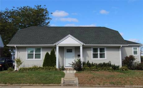 Single Family Home Sold in Bridgeport CT 06606. Old ranch house near beach side waterfront with 1 car garage.