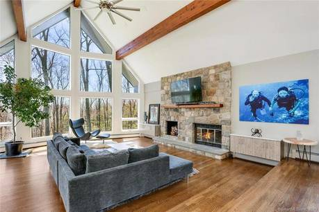 Single Family Home Sold in Redding CT 06896. Contemporary house near waterfront with 4 car garage.
