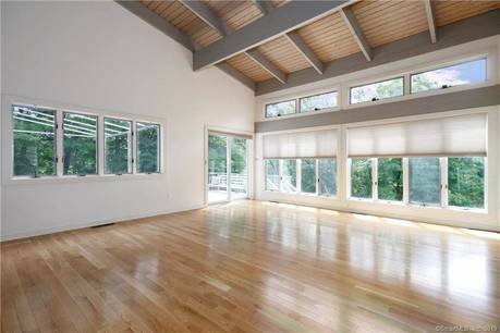 Single Family Home Sold in Wilton CT 06897. Contemporary, ranch house near river side waterfront with 2 car garage.