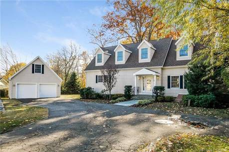 Single Family Home Sold in Greenwich CT 06807.  cape cod house near waterfront with 2 car garage.