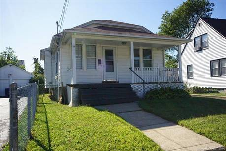 Single Family Home Sold in Bridgeport CT 06606. Old  bungalow house near waterfront with 2 car garage.